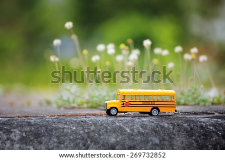yellow school bus toy model on...