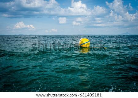 Yellow Sea Buoy in blue Sea at Andaman Sea, Thailand