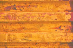 Yellow sea freight cargo container background, rusty corrugated pattern, horizontal rusted detailed steel texture, cracked grungy metal paint detail, old aged weathered textured rust grunge closeup