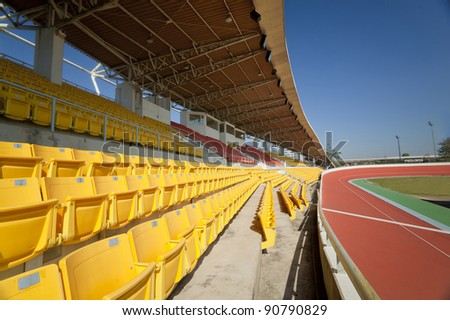 Yellow seat in velodrome stadium with blue sky