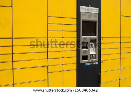 Yellow self-service automated post terminal machine for parcel