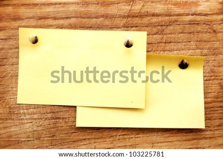 yellow sheet on wooden board