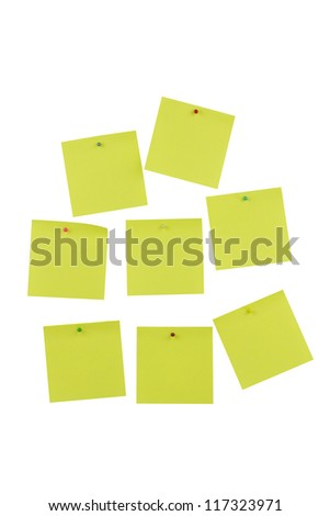 Yellow sheets for notes pinned with colorful pins isolated on white