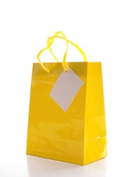 yellow shopping bag isolated on white background
