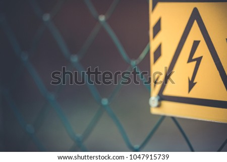 Yellow sign high voltage Danger to life #1047915739