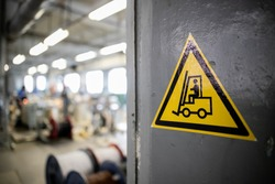 Yellow sign in a warehouse, production - forklift works