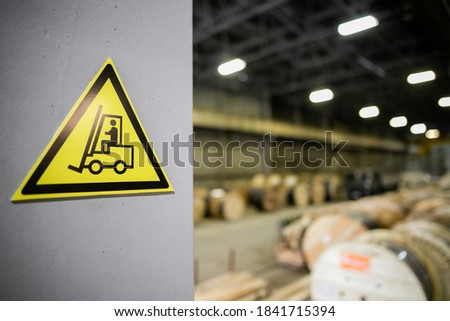 Yellow sign in a warehouse, production - forklift works Photo stock ©
