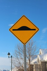 Yellow sign on blue sky. Roadsign.