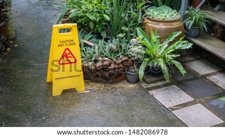 Yellow sign that alerts for wet floor. #1482086978