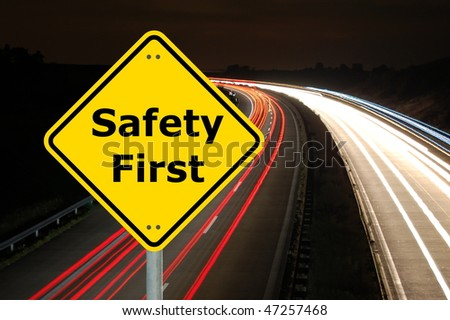 yellow sign with safety first as aid concept