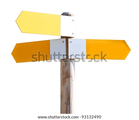 Yellow signs on a wooden pole
