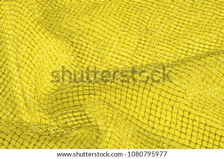 Yellow silver mesh fabric, with a woven metallic thread. Bring it back in the 1920s with this extravagant silvery and black geometric yellow mesh. Grab it while he's still here, #1080795977