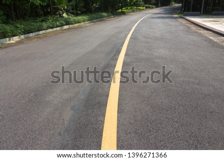 Yellow single solid asphalt curved road #1396271366