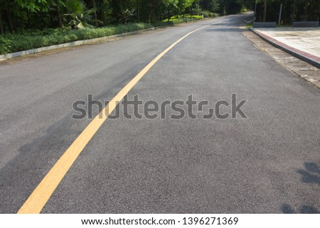 Yellow single solid asphalt curved road #1396271369