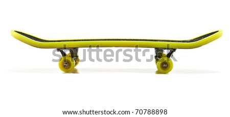 yellow skateboard isolated on a white background