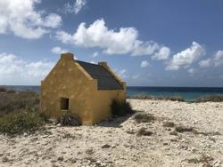 Yellow slave house and blue sky on Caribbean beach - Bonaire Netherlands Antilles