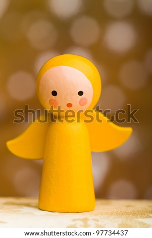 Yellow small wooden christmas angel with wings