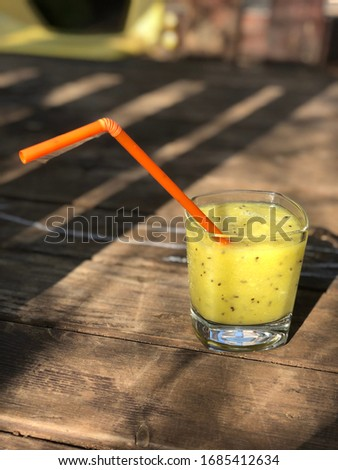 Yellow smoothie on the table Сток-фото ©