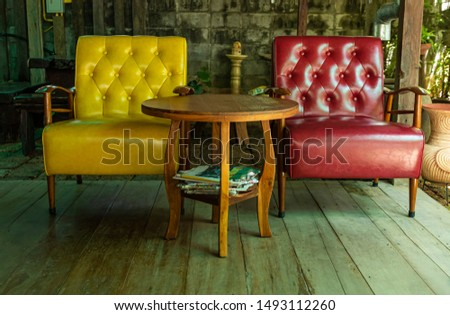 Yellow sofa and red sofa on the wooden floor at terrace. #1493112260