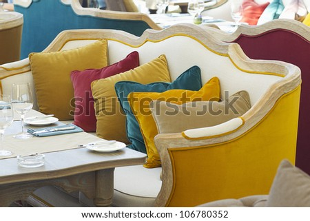 yellow sofa in a luxurious restaurant with a few colorful pillow