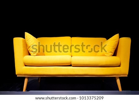 Yellow sofa in dark room with dim light background. #1013375209