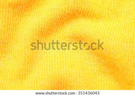 yellow soft knitting wool moher texture background, selective focus #351436043