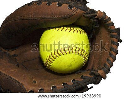 Yellow softball in a catcher's glove isolated on a white background