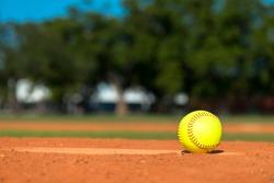 Yellow softball on pitchers mound