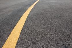 Yellow solid line asphalt pavement