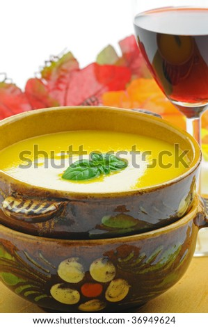 Yellow soup made with squash, corn and peppers.