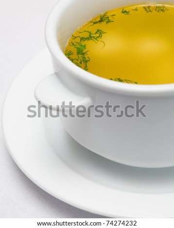 yellow soup with greens