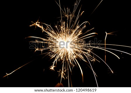 yellow sparkler holiday background on black