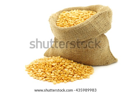 yellow split peas in a burlap bag on a white background #435989983