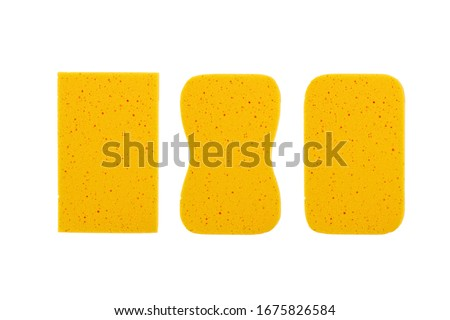 Yellow sponge isolated on white background. for cleaning and washing car  Foto stock ©