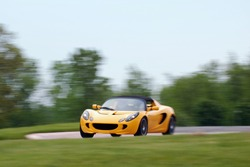 Yellow sports car racing at a open track day