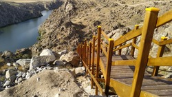 yellow stairs leading from the canyon to the river