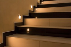 Yellow stairs up with illumination at night