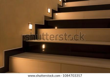 Yellow stairs up with illumination at night