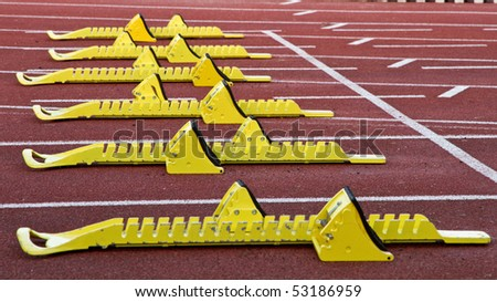 yellow starting blocks in track and field