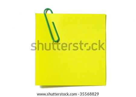 Yellow sticker note with a green clip isolated on white background