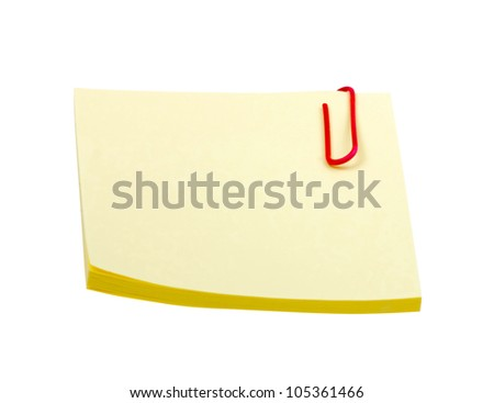 Yellow sticker note with clip isolated on white background - stock photo