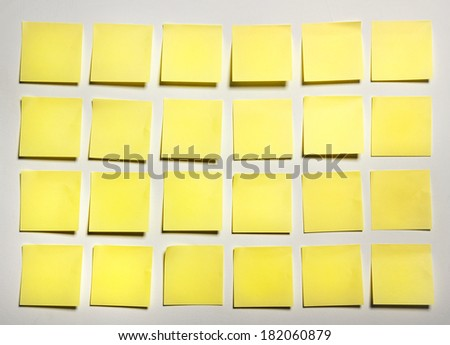 Yellow sticks note on white background, photo