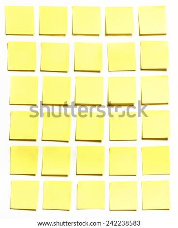 Yellow sticks note on white background, photo