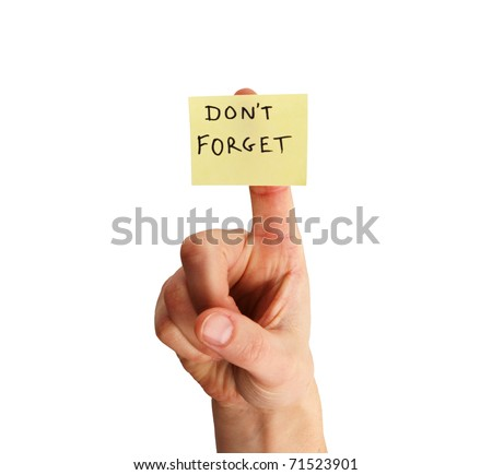 yellow sticky note saying don't forget on a woman's finger isolated on white background