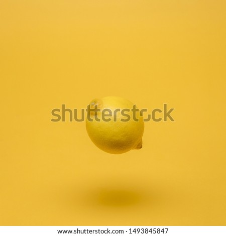 Yellow still life of floating lemon