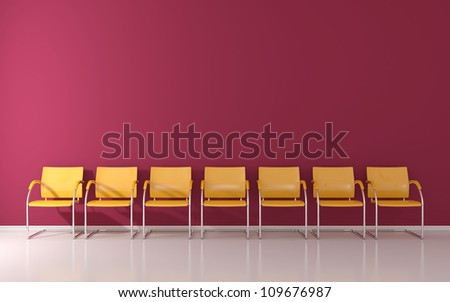 Yellow stools on burgundy wall in the waiting room