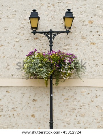 Yellow street lamps in small countryside city. France.