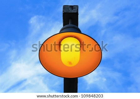 Yellow street lamps with blue skies.