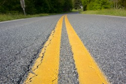 Yellow stripes mark the center of the road in rural Virginia