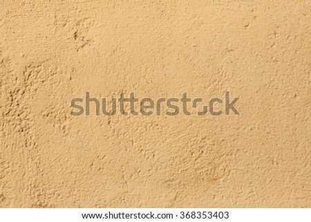 Yellow stucco wall. Background texture. #368353403